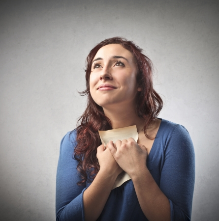 palpitations: Woman having love palpitations for a letter from her lover Stock Photo