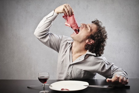 Man swallowing a steak photo