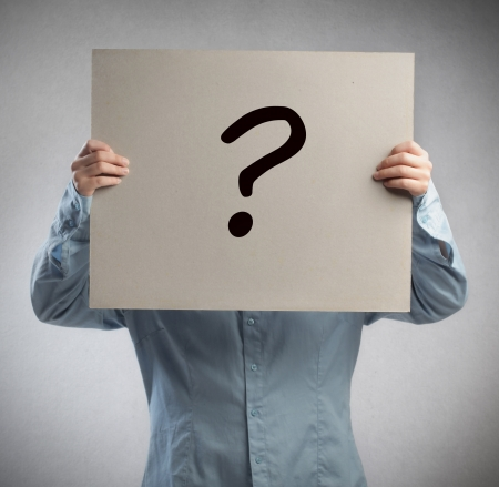 Man holding a cardboard on which is drawn a question mark Stock Photo - 15930208
