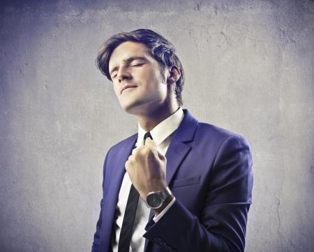 exult: Businessman rejoicing for his success