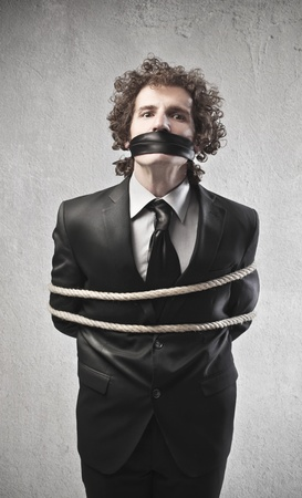 gagged: Businessman tied with a rope and gagged