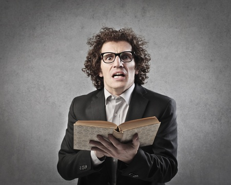 Professor reading a book aloud Stock Photo - 15930177