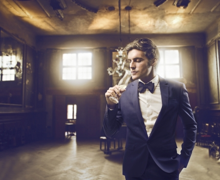champagne flute: Man in an elegant location Stock Photo