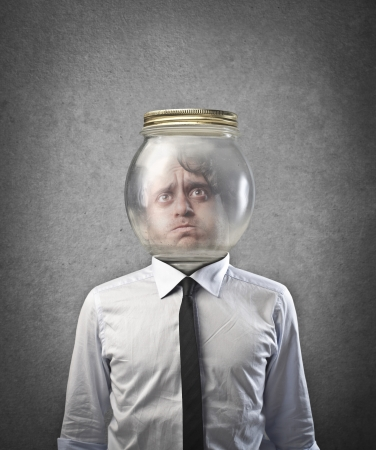 Man with the head trapped in a glass container photo