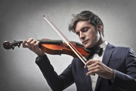 violins: Violinist playing his violin