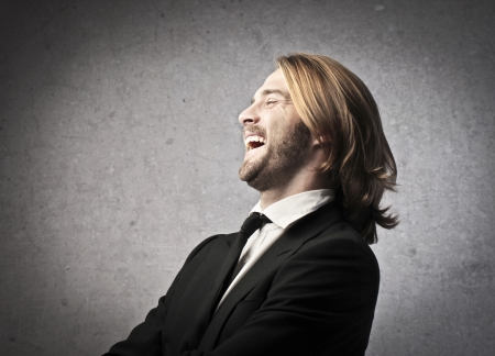 Man with long blonde hair laughing photo