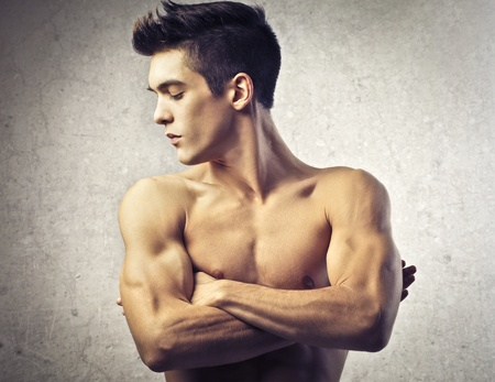 naked youth: Brown guy looking at his muscles