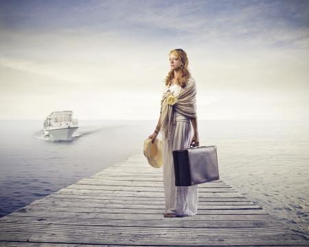 wharf: Woman waiting for a boat on a wharf