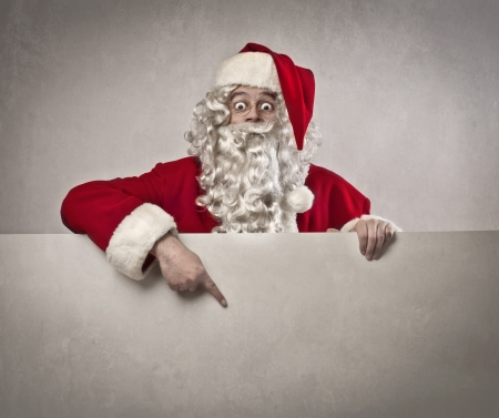 Santa Claus indicating something on a white poster