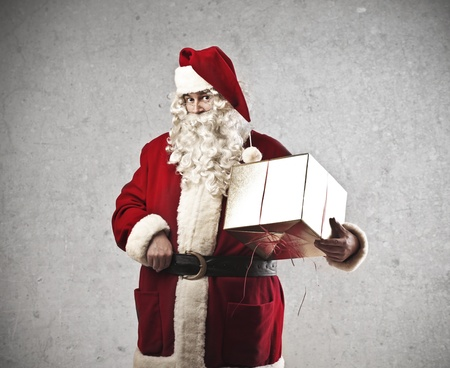 Santa Claus holding a present photo