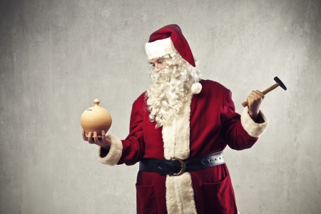 Santa Claus is going to break a vessel full of money photo