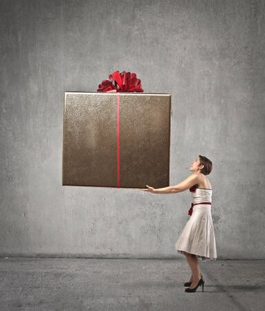 Woman holding a giant present