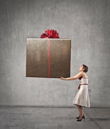 big women: Woman holding a giant present