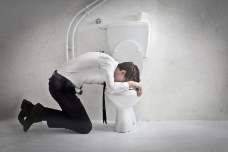 reproach: Young businessman puts his head in a toilet