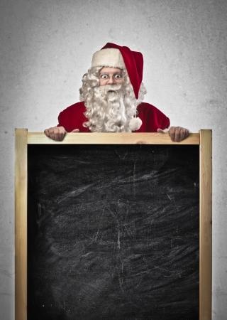 elenchi: Babbo Natale con una lavagna vuota