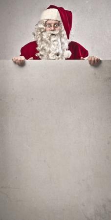 stupor: Santa Claus sobre un cart�n blanco Foto de archivo