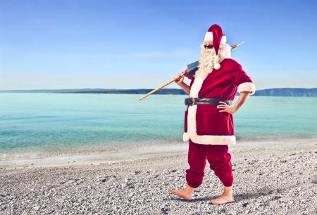 산타 클로스: 해변에서 산타 클로스 스톡 사진