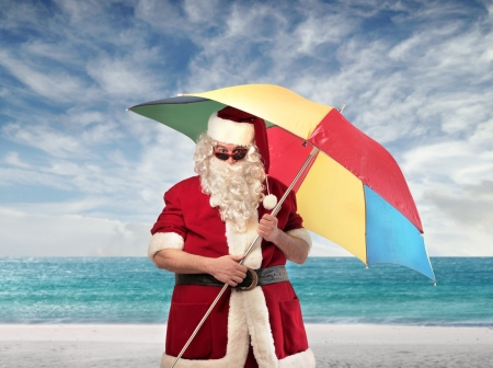 Santa Claus with a beach umbrella photo