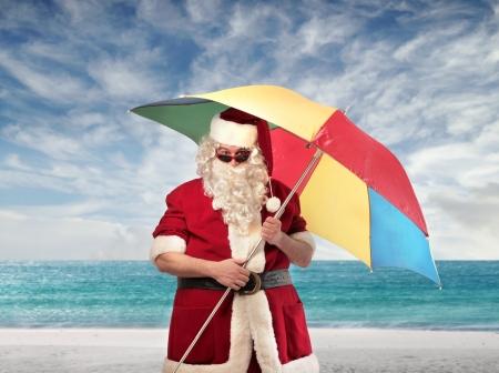 Santa Claus with a beach umbrella