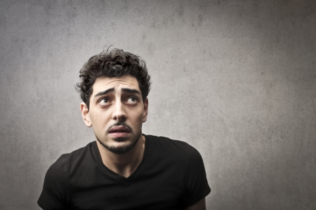 Afraid guy in black Stock Photo - 16621184