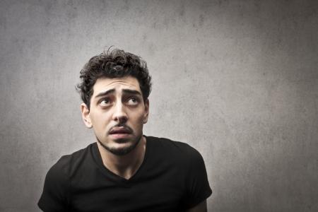 Afraid guy in black