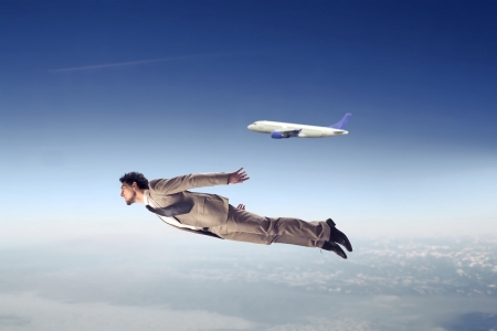 Young businessman flying near an airline