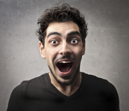 stupor: Surprised guy in black Stock Photo
