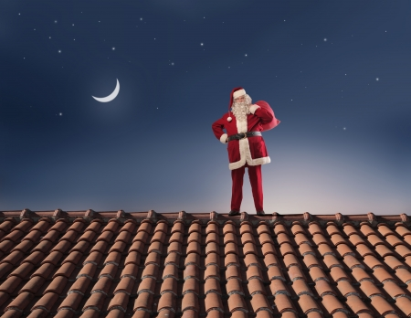 Santa Claus on a roof Stock Photo