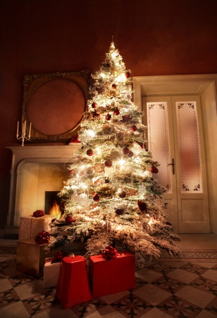 beautiful christmas tree with gift boxes in the living room with fireplace photo