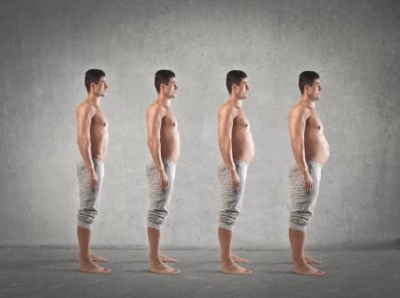 männer nackt: Evolution schöne magerer Kerl mit einem dicken Bauch Lizenzfreie Bilder
