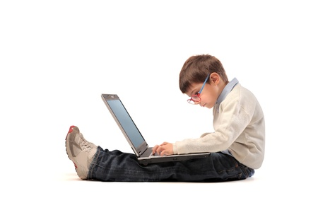 baby sitting on the floor with laptop writing on a white background photo