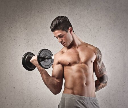 handsome muscular boy weight up Stock Photo - 17238682