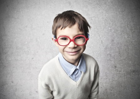 portrait small child smiling with red glasses photo