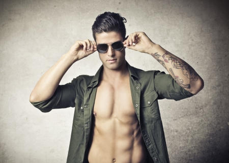 nude man: handsome muscular guy wearing sunglasses
