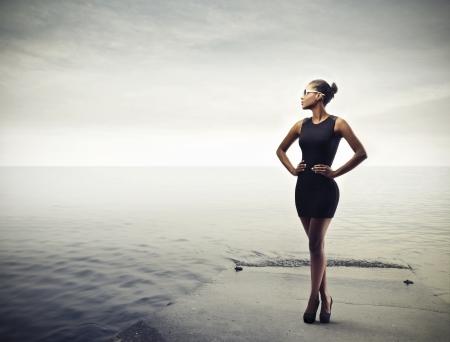 beautiful black woman with black dress photo