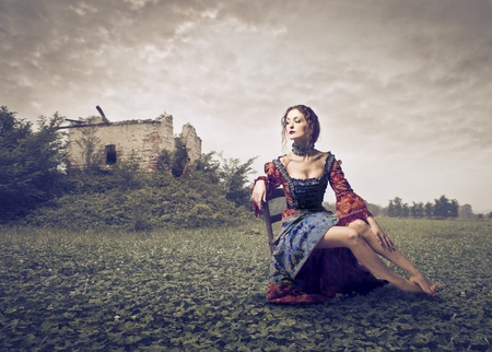 broken house: beautiful lady of the eighteenth century with behind landscape with building decadent Stock Photo