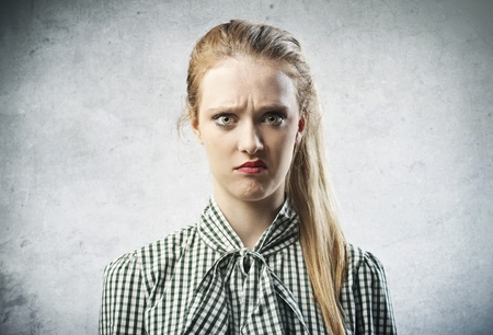 suspicious: portrait of blonde girl disgusted
