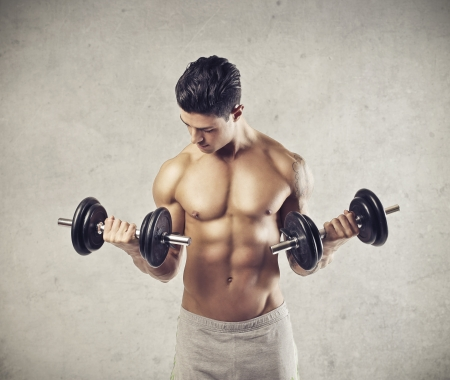 handsome young man with muscles takes place in weight training Stock Photo - 17230502