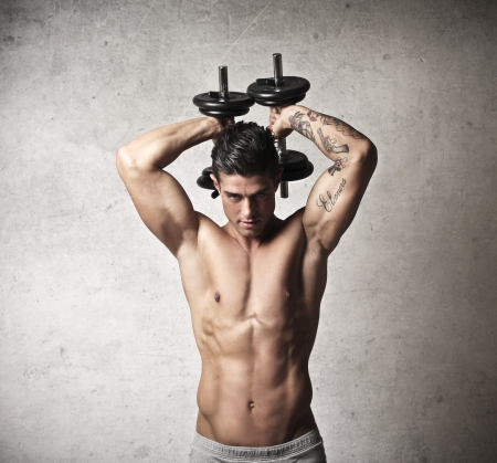 handsome young man with muscles takes place in weight training Stock Photo - 17230509