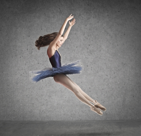beautiful dancer in blue tutu on gray background photo