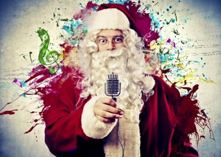 liar: santa with microphone in hand on colored background abstract Stock Photo