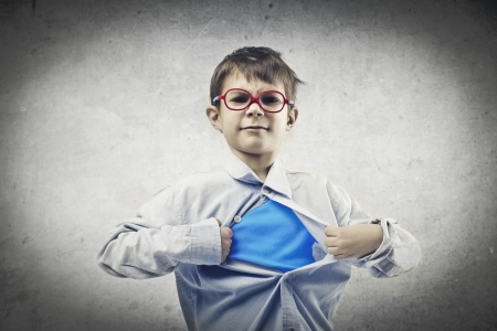 super man: baby opens his shirt and shows shirt super hero Stock Photo