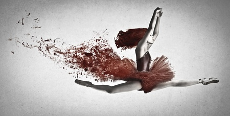 beautiful dancer with red tutu dancing on a gray background photo