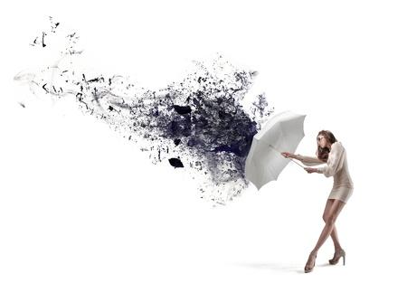 beautiful girl with umbrella on white background photo