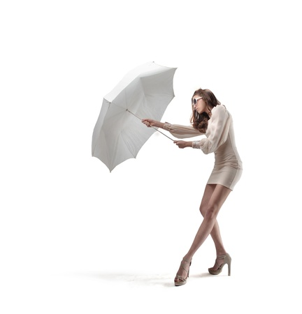 spurn: beautiful girl with umbrella on white background