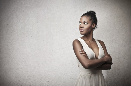 beautiful black woman with white dress on a gray background