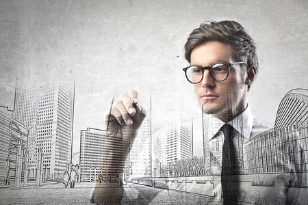 architect: businessman drawing on whiteboard
