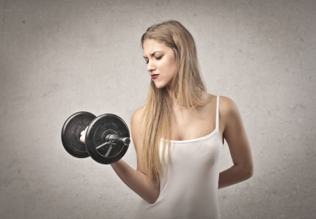 bicep: blonde girl gets a lot of effort doing weight