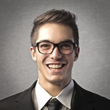 portrait of young businessman on gray background Stock Photo - 17478015