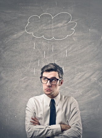 businessman with drawing rain cloud over his head Stock Photo